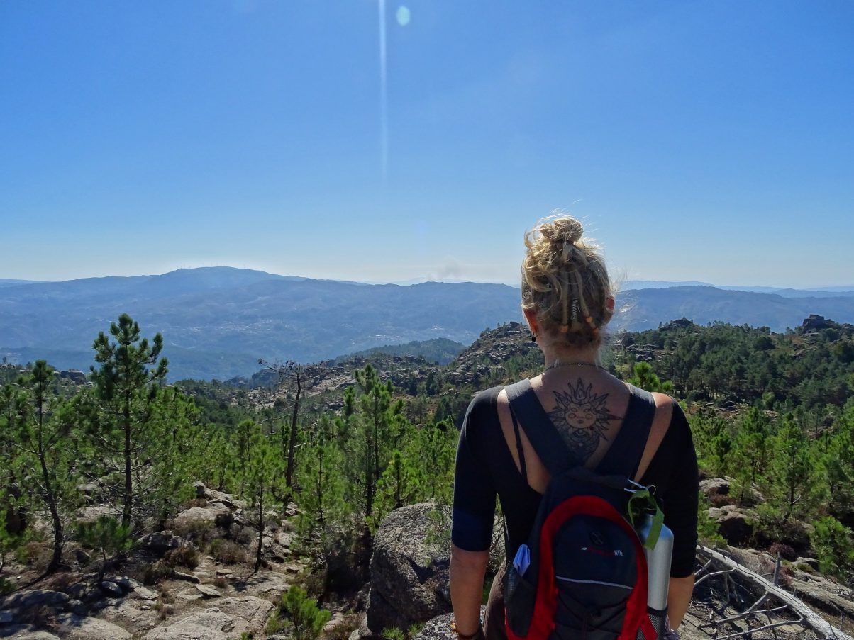 Girl overlooking mountains on hiking trail in Peneda-Gerês National Park