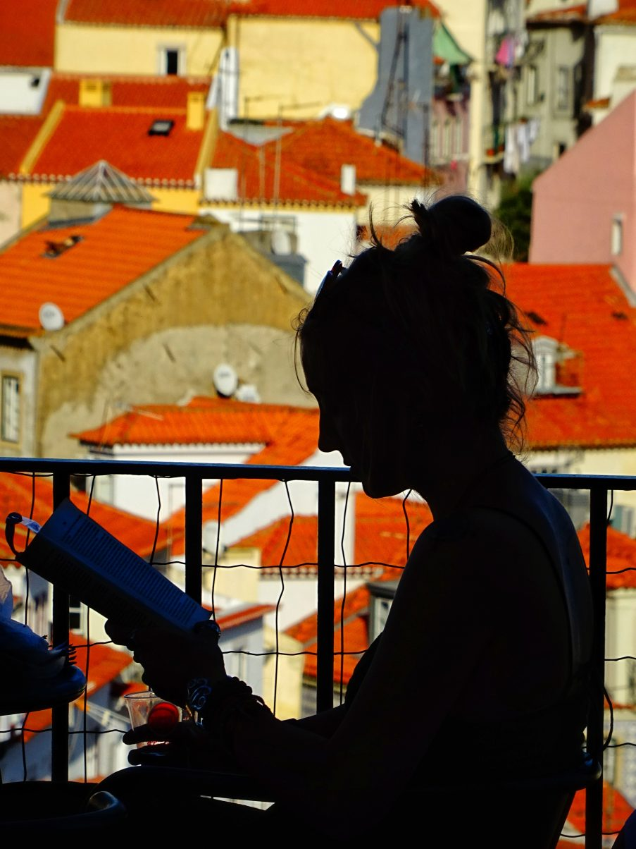 Girl reading in Lisbon