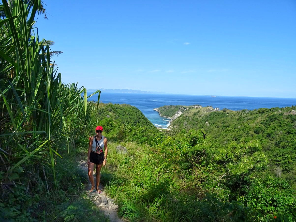 Girl hiking to tropical beach