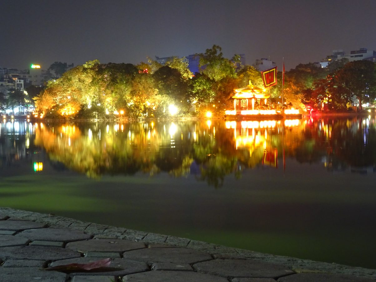 Hoan Kiem lake at night brightly lit with lights, Vietnam