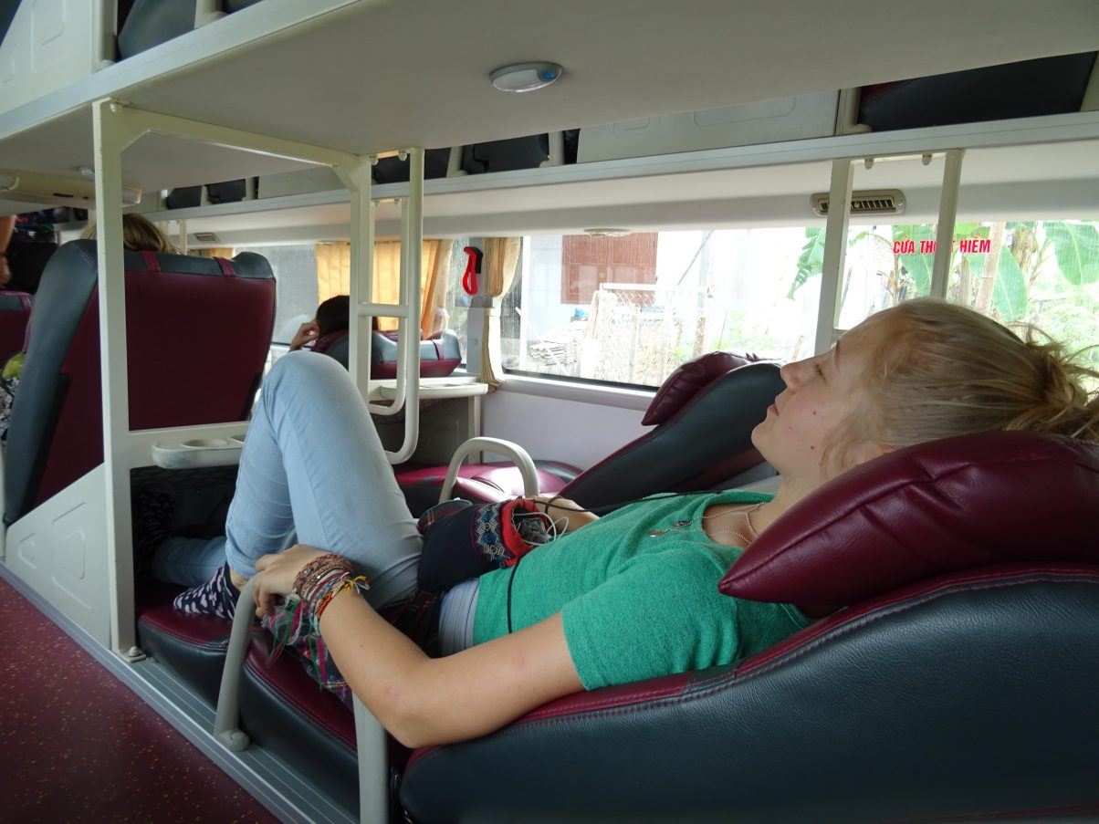 Girl sleeping on sleeper bus Asia