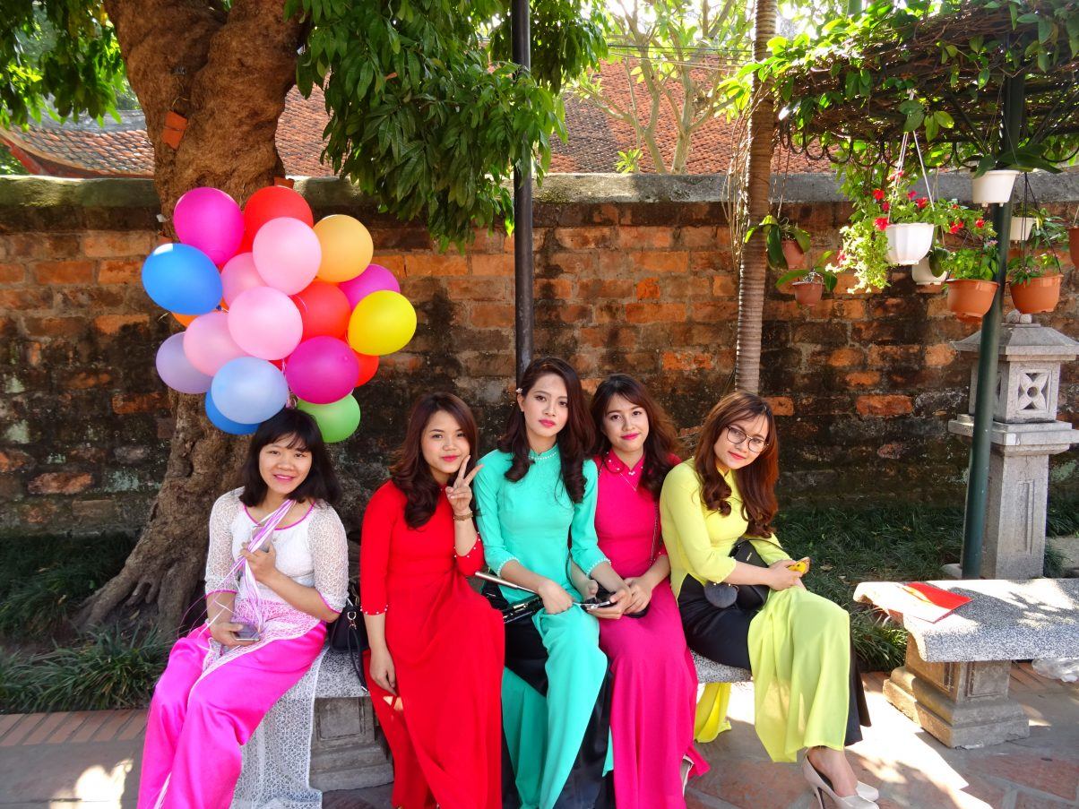 Vietnamese beautiful girls wearing traditional dresses