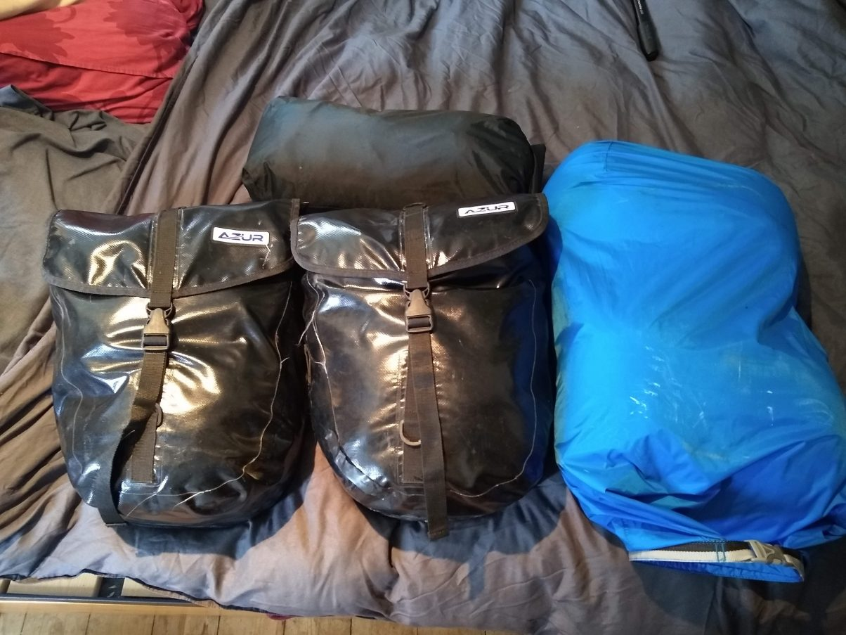 Cycle panniers filled with gear
