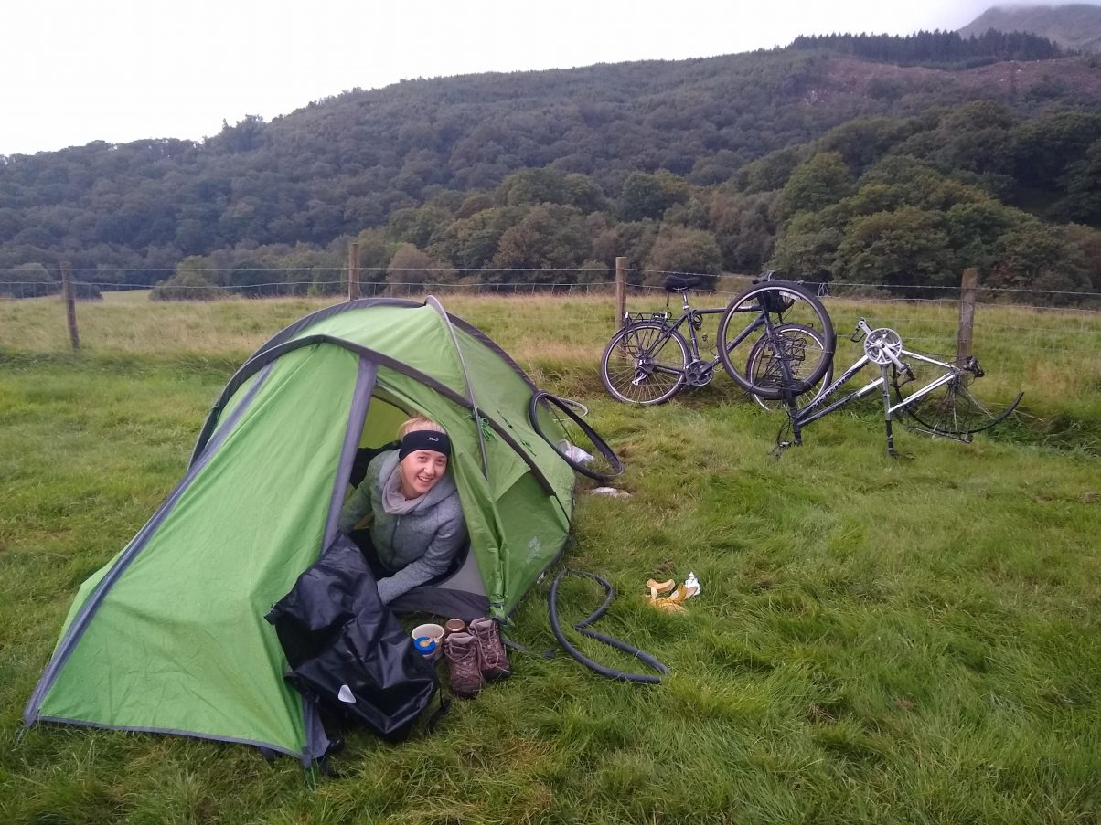 Tent in field camping with bikes