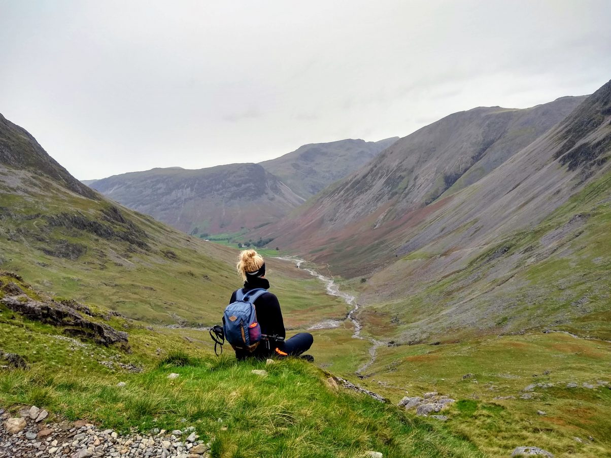 Girl looking into mountains