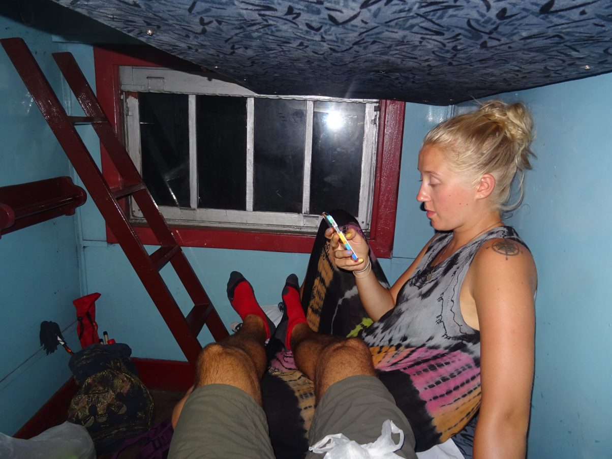 Couple in sleeper train overland travelling