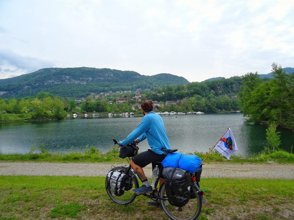 Man bike touring near lake