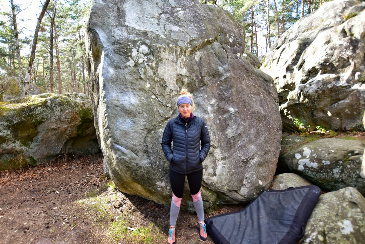 Female climber with crash pad
