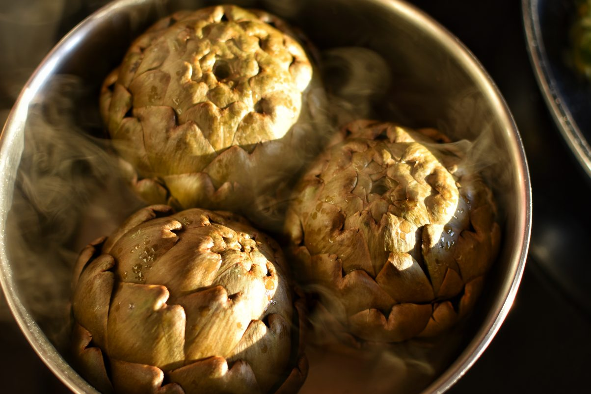 Artichokes cooking in pot - vegan food in France