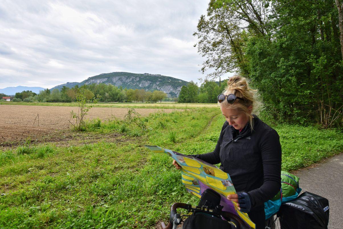 Women cycling reading map