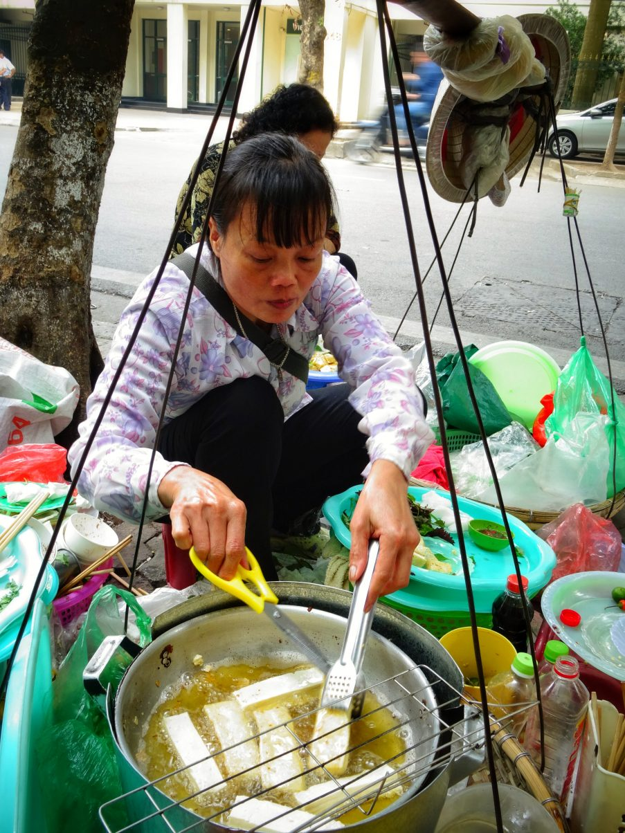 Women frying tofu in Hanoi