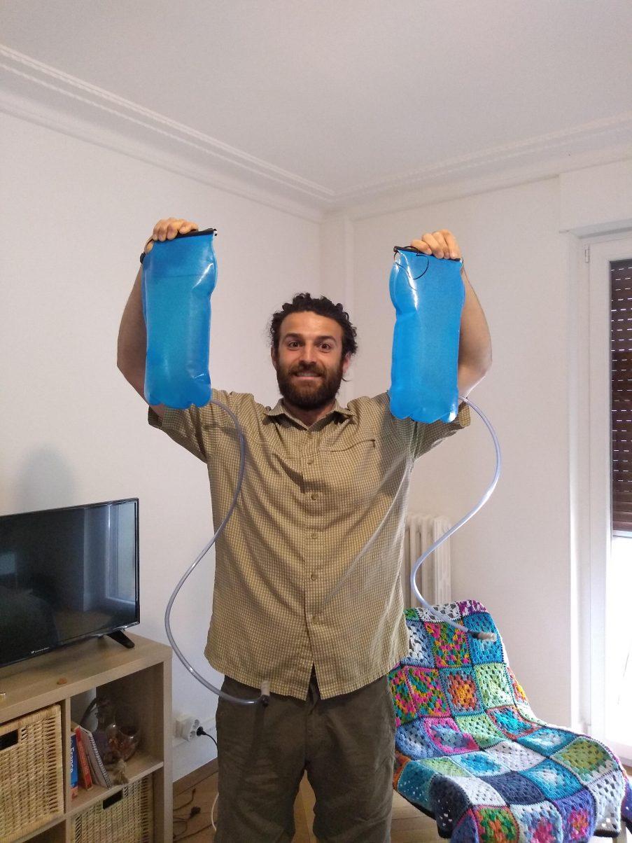 Hiking man carrying water bladders