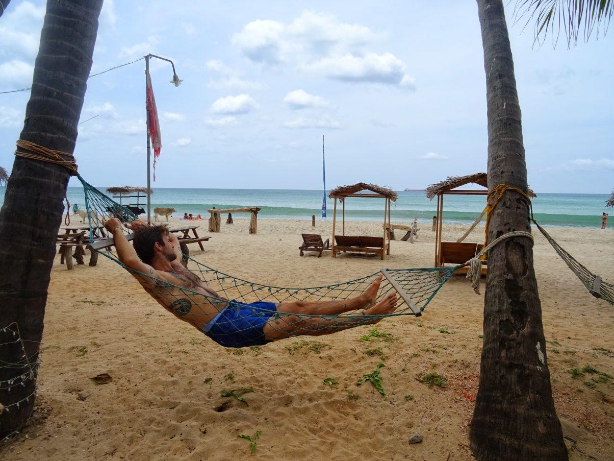 Man in hammock on beach