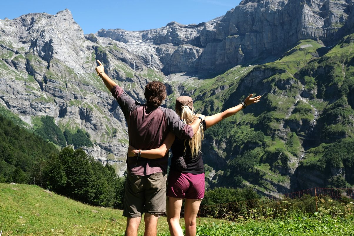 Couple overlooking Alps Mountains