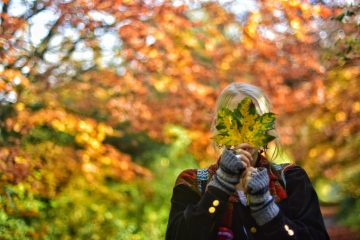 Girl with leaf over face