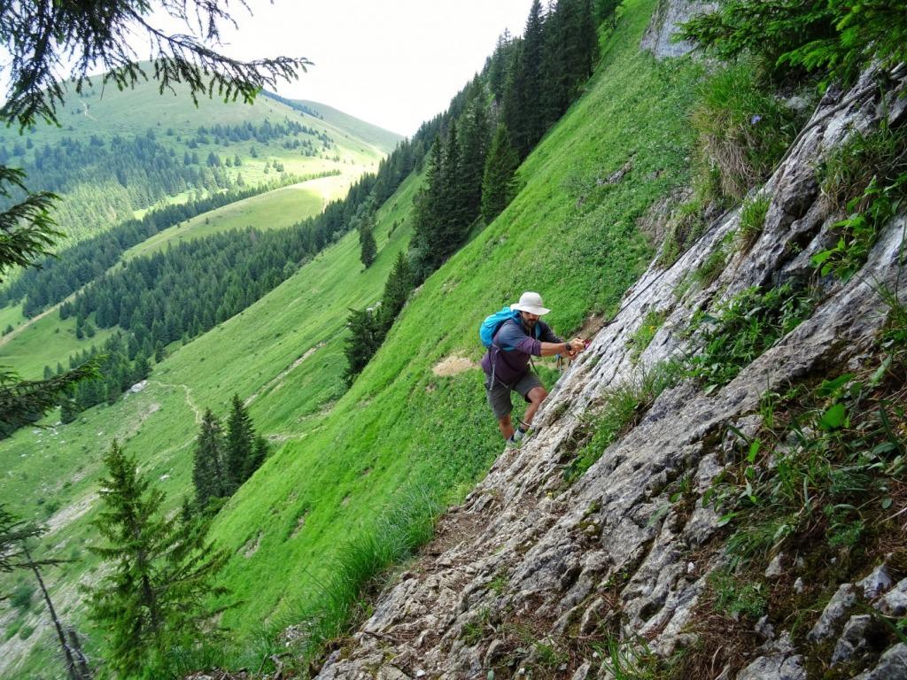 Man scrambling up mountain