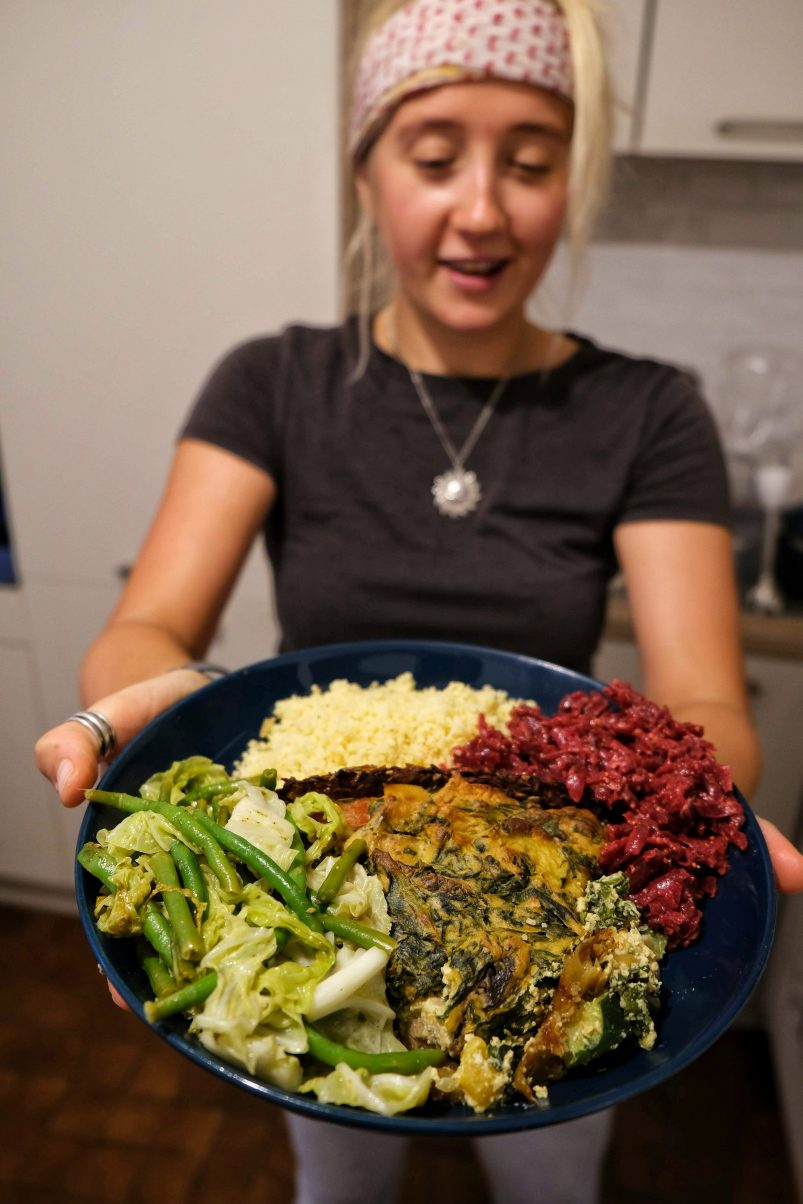 Girl holding plate of food