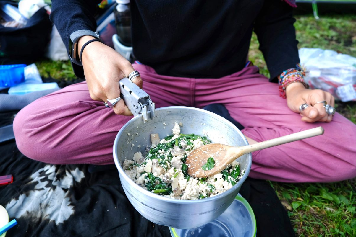 Food being cooked on camp stove outdoors