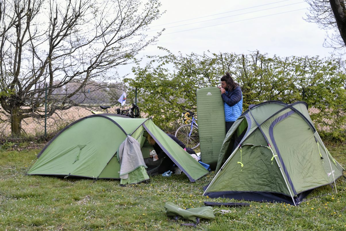 Man pitching tent in the outdoors