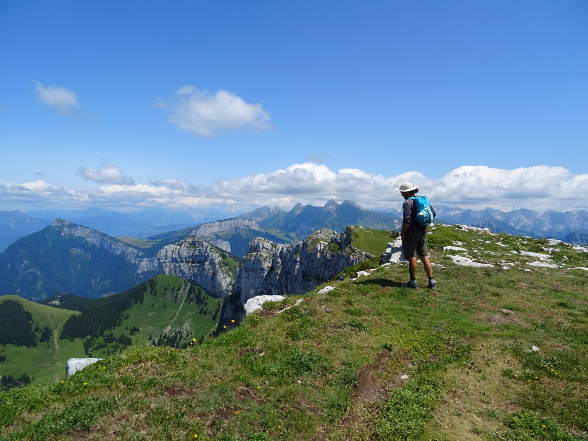 Man overlooking mountain ridge in the French Alps