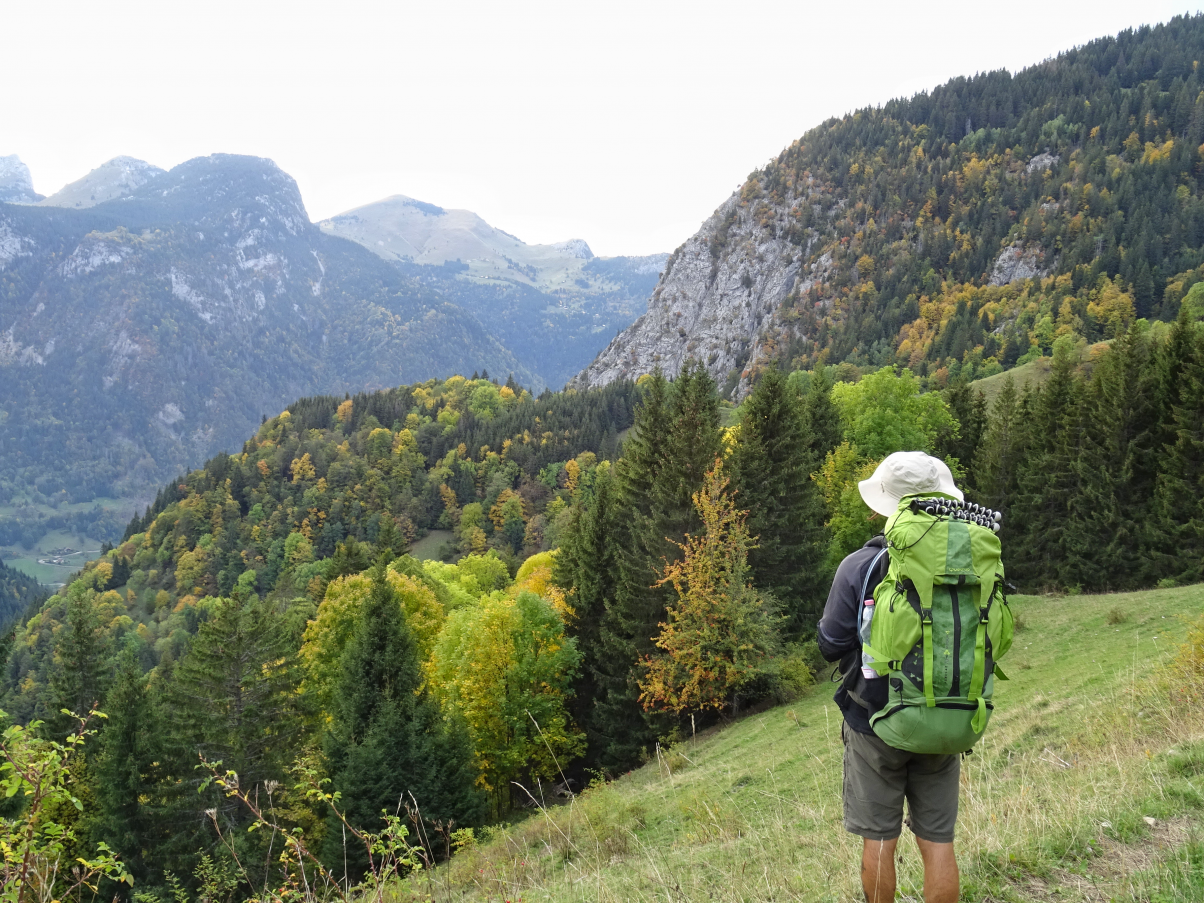 Man hiking with big rucksack in the mountains