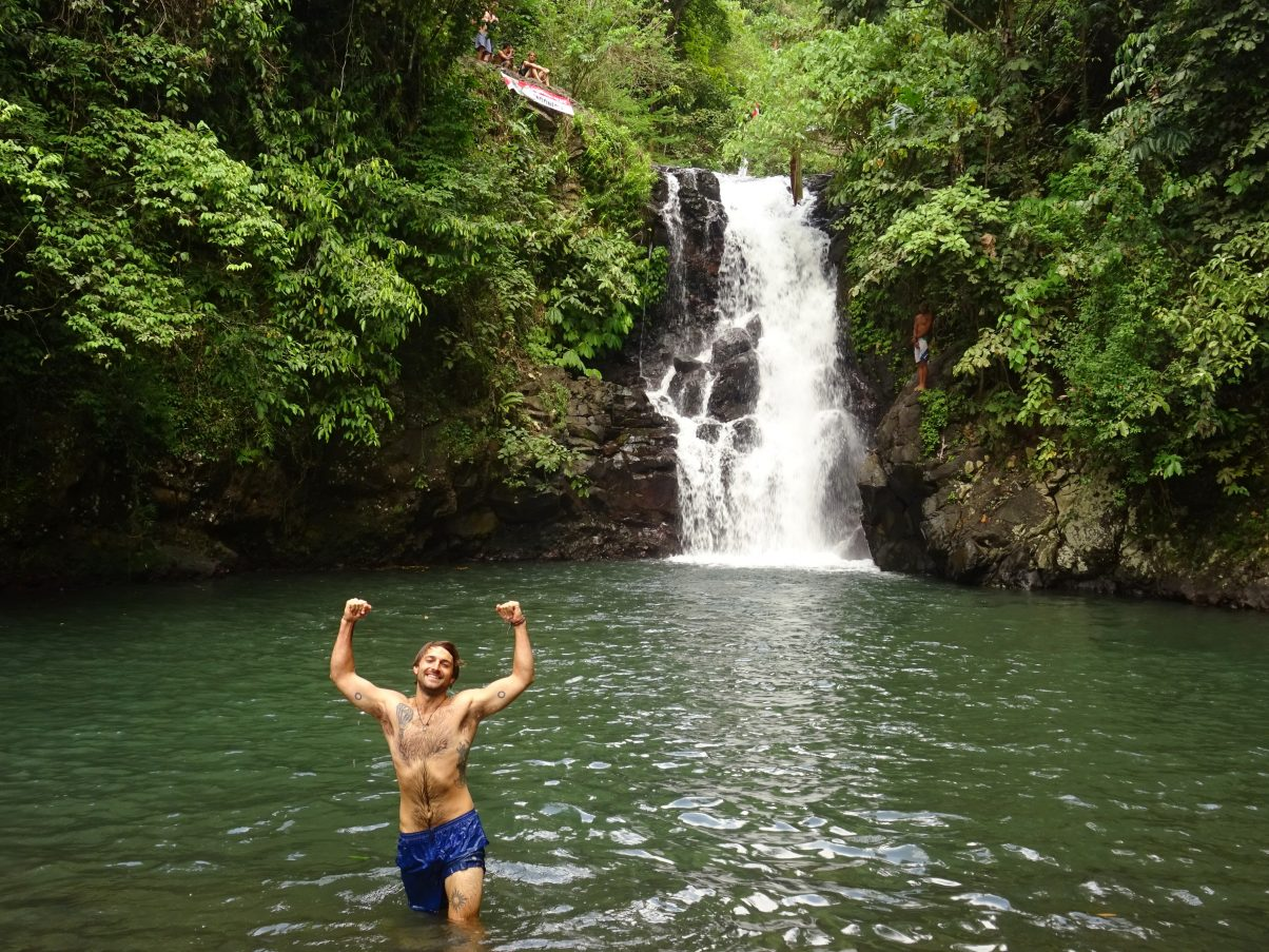 Man jumping into waterfall