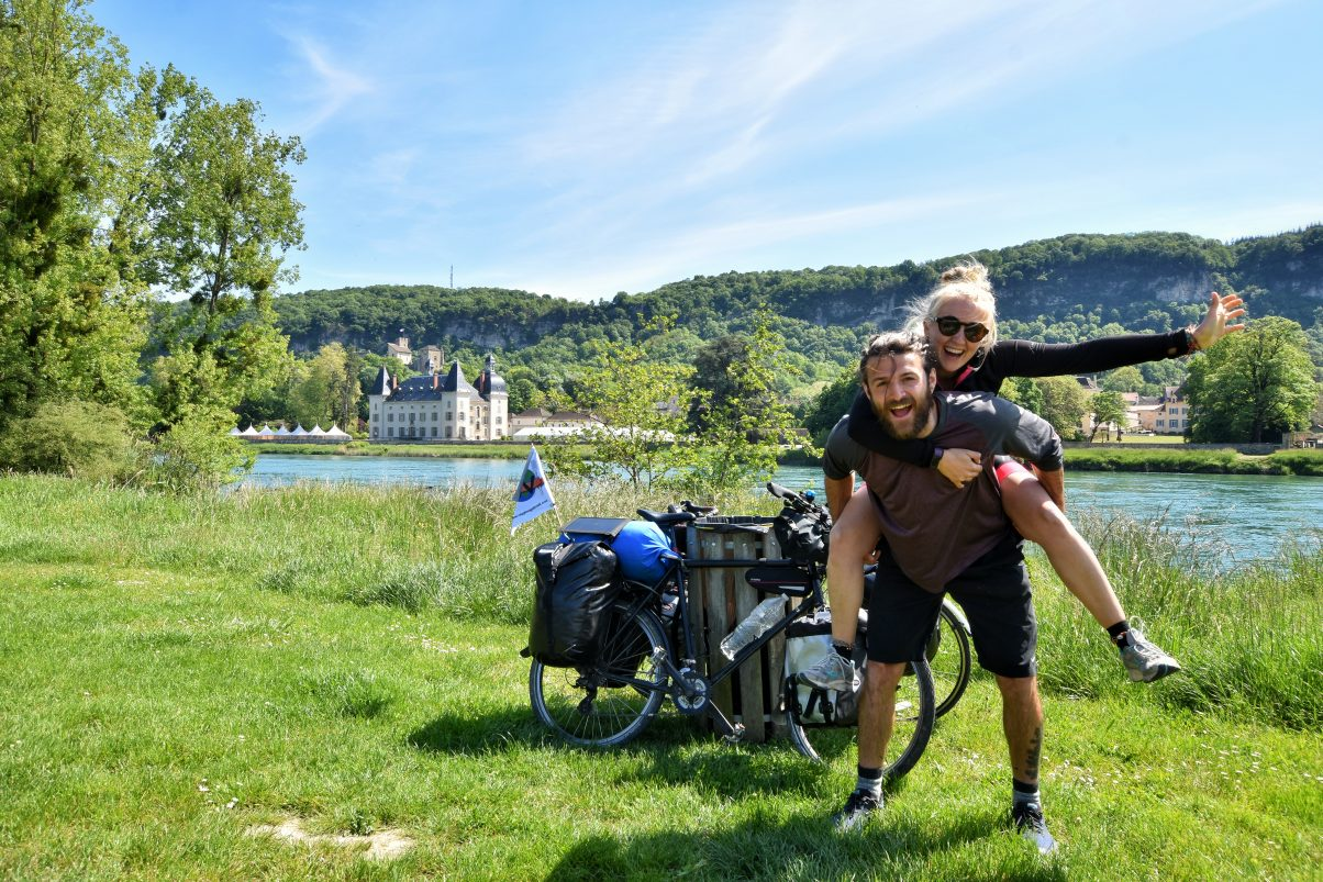 Man and women biker touring looking happy