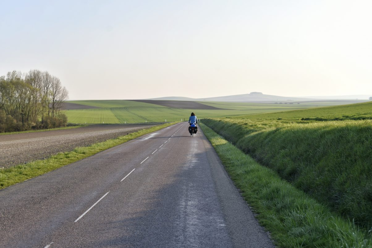 Man riding bike touring route
