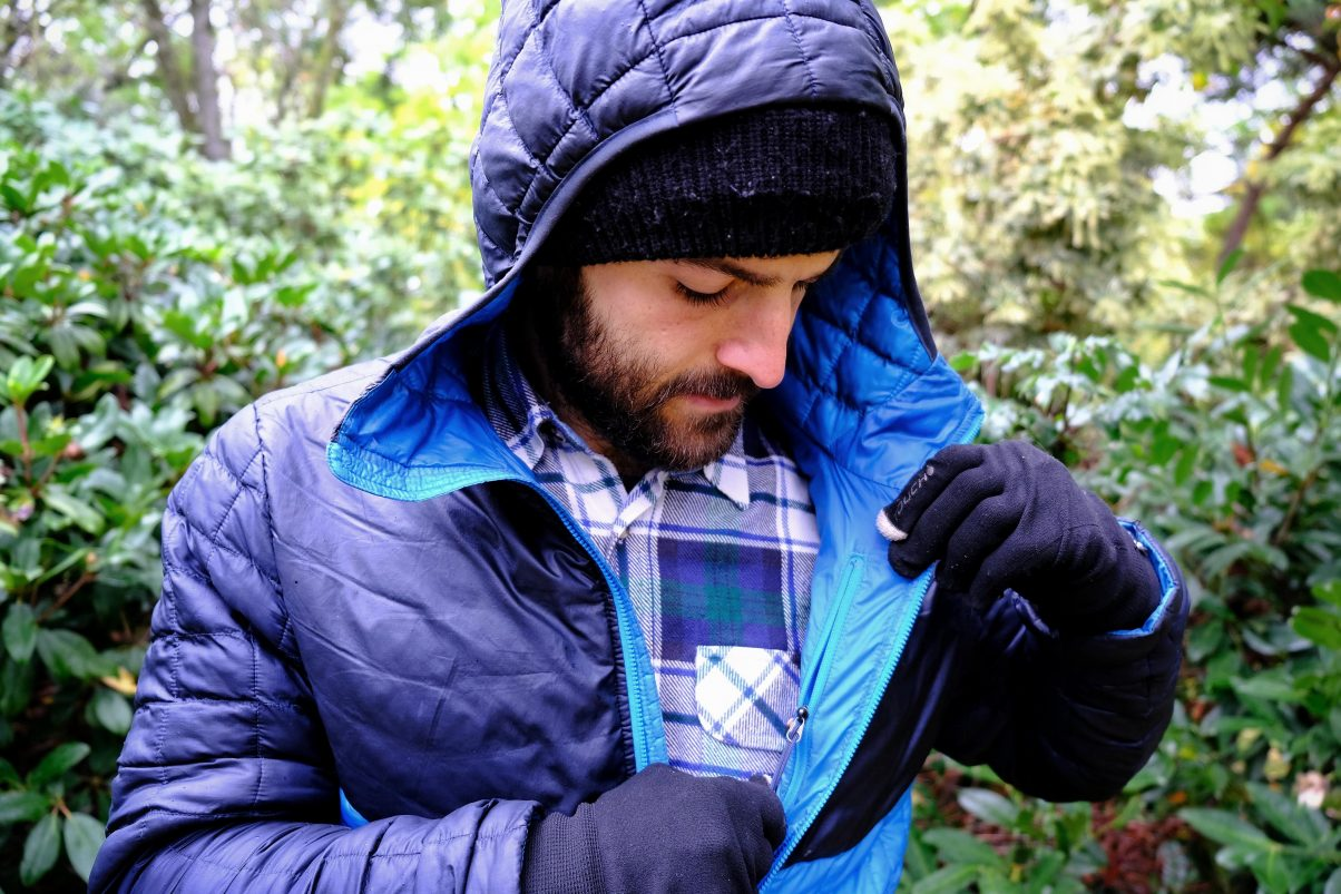 Showing the inner pocket on a North Face Thermoball coat