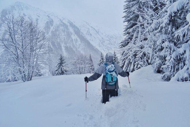 Man hiking through snowy mountains