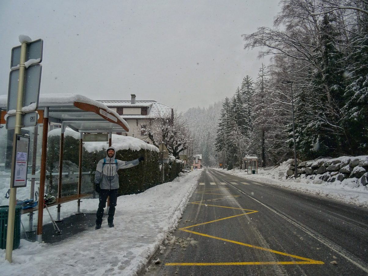 Man at bus stop in snow