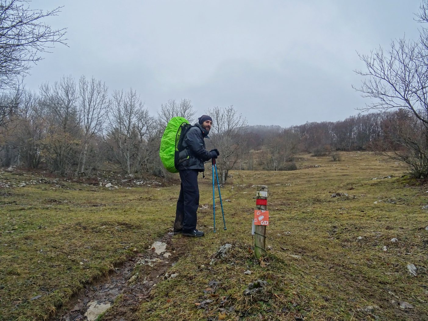Hiker in the Jura Mountains with large rucksack on