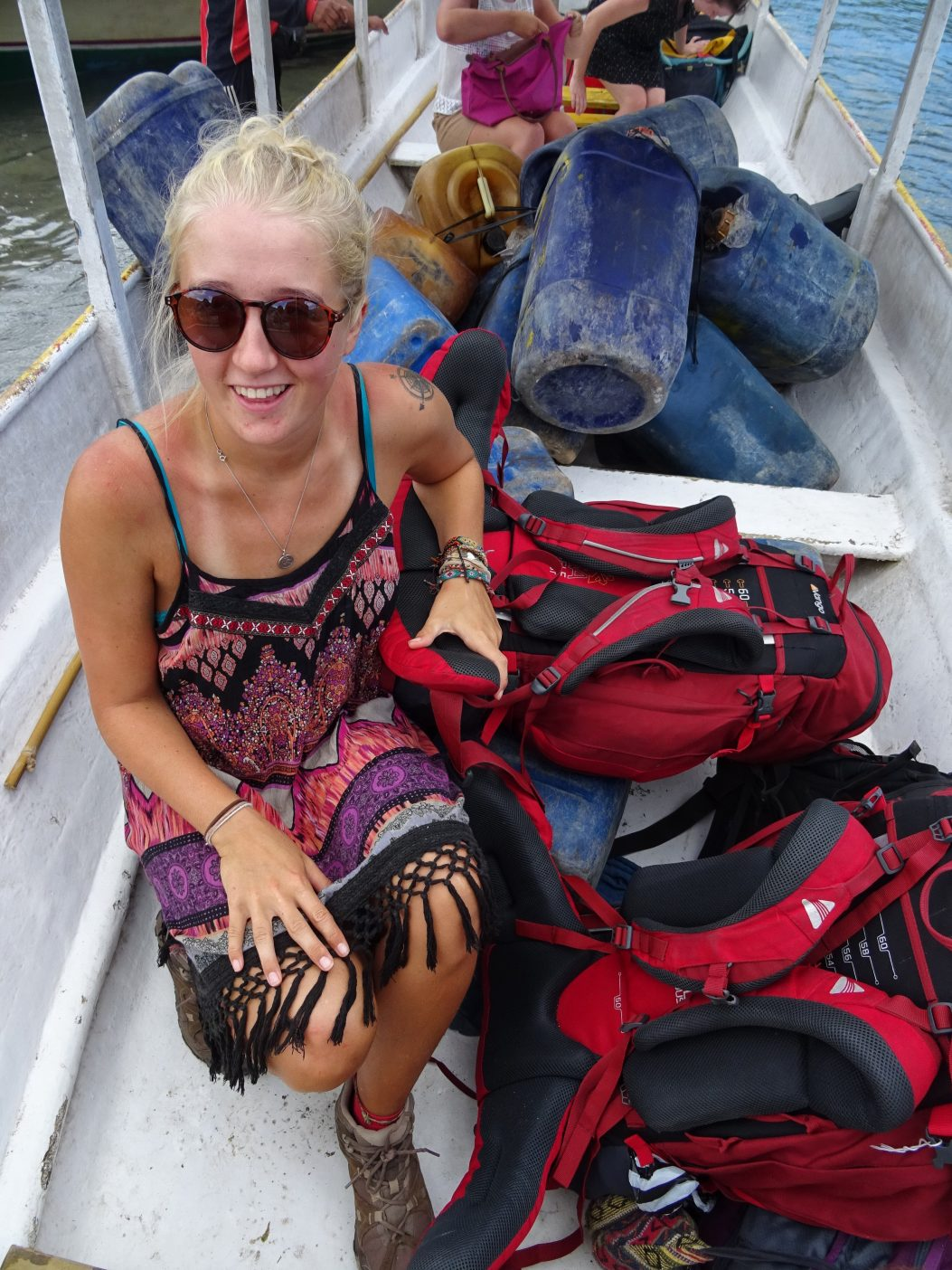 Girl with backpacks travelling on boat