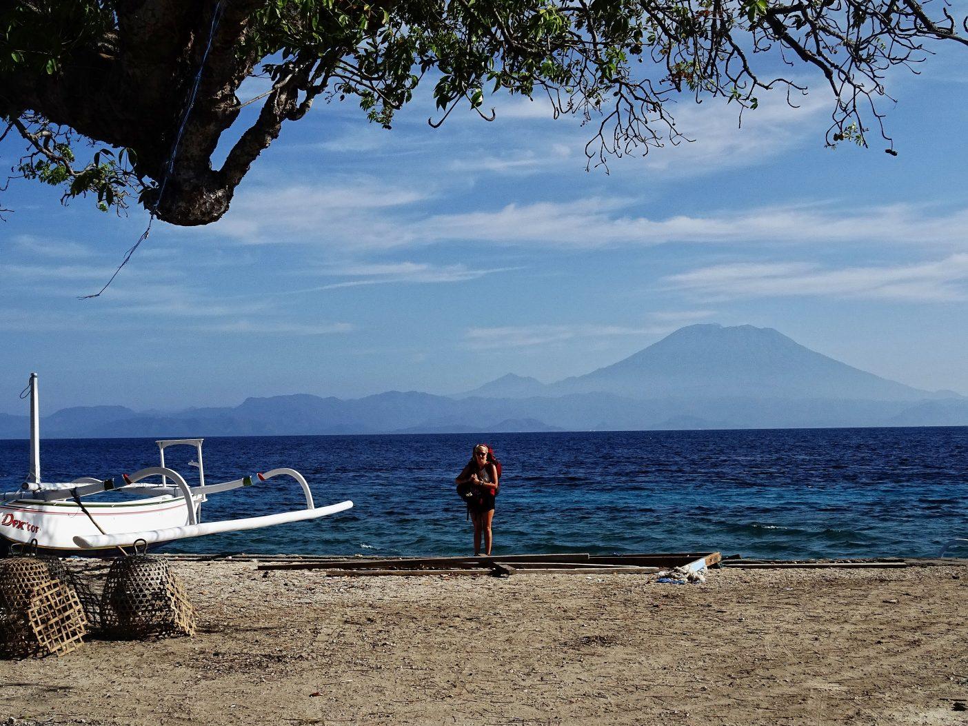 Girl backpacking on tropical island