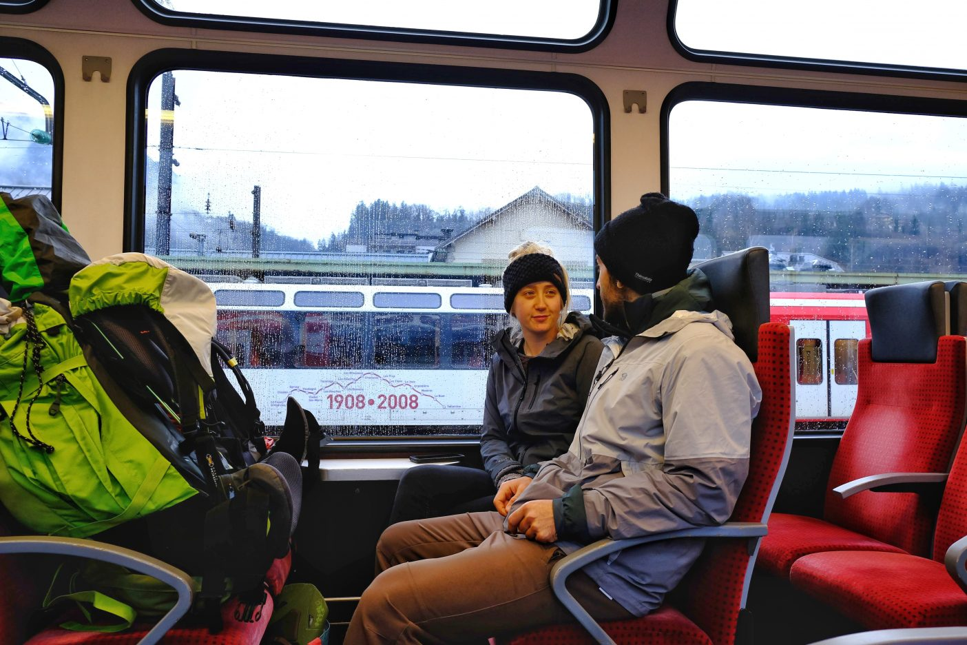 Backpacking couple travelling by train