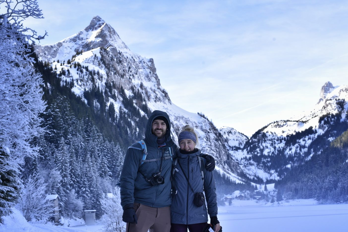 Couples hiking on frozen Lac de Taney, Switzerland
