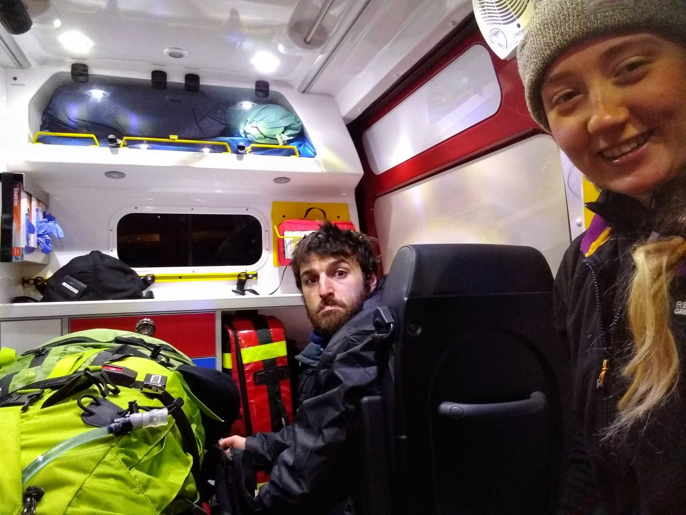 Two hikers in mountain rescue ambulance