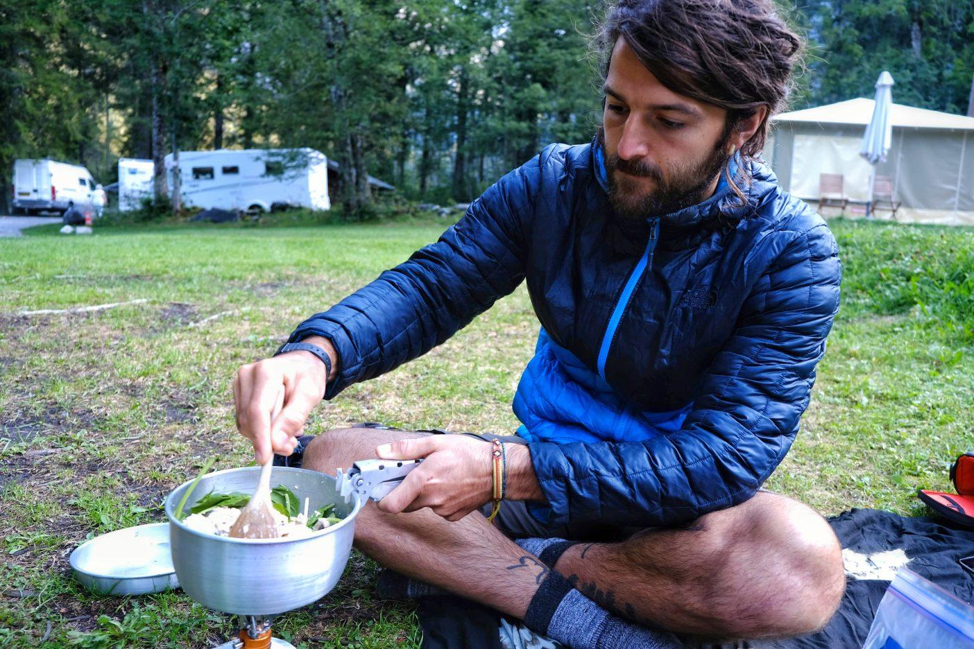 Man making vegan backpacking recipes