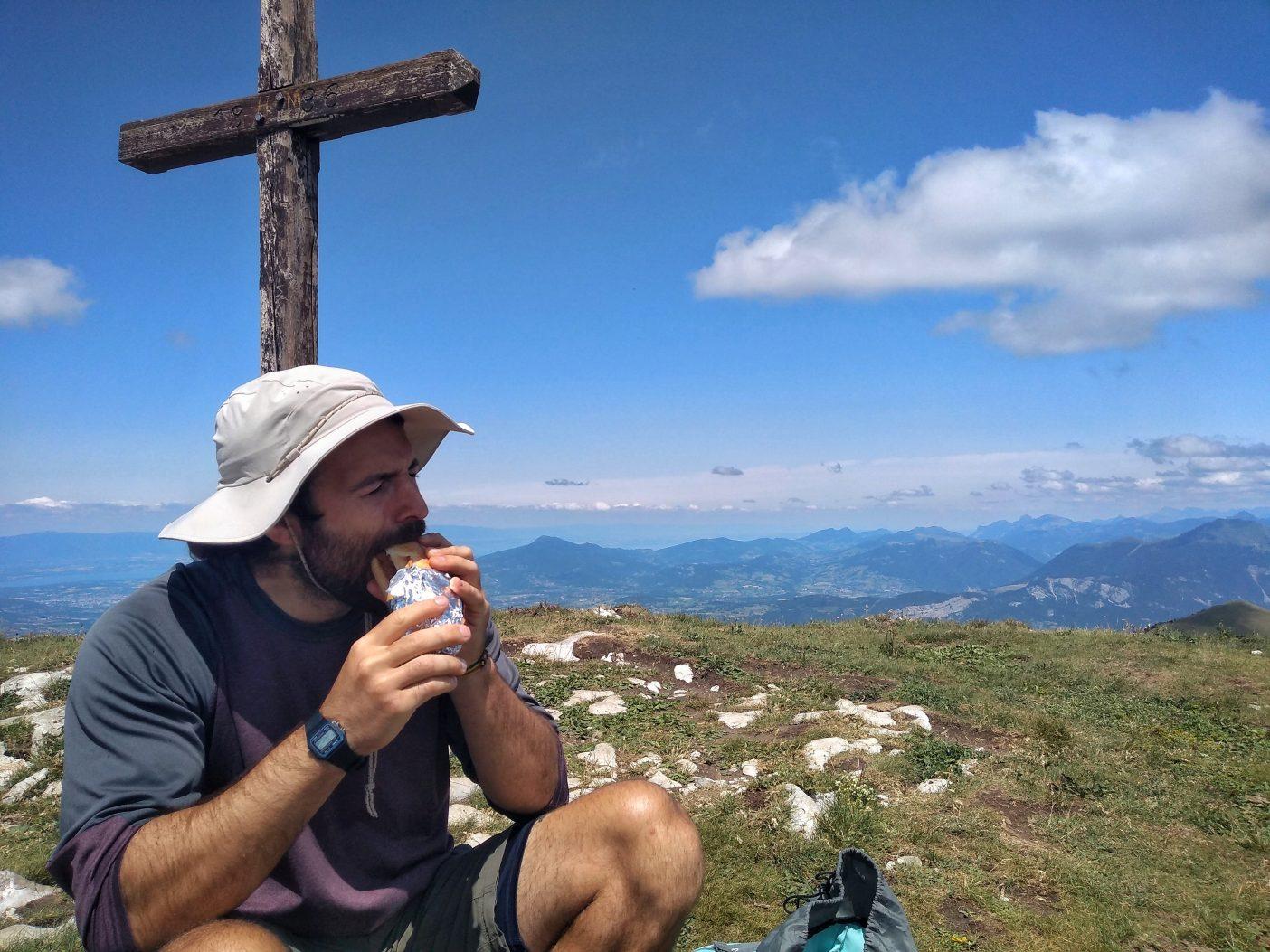 Man eating vegan day hike food