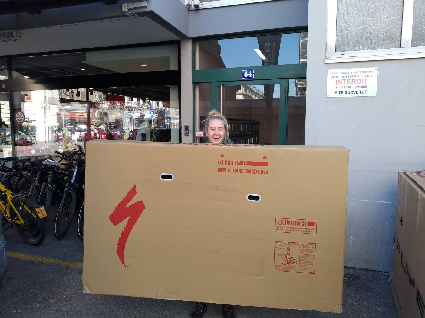 Girl carrying big bike box
