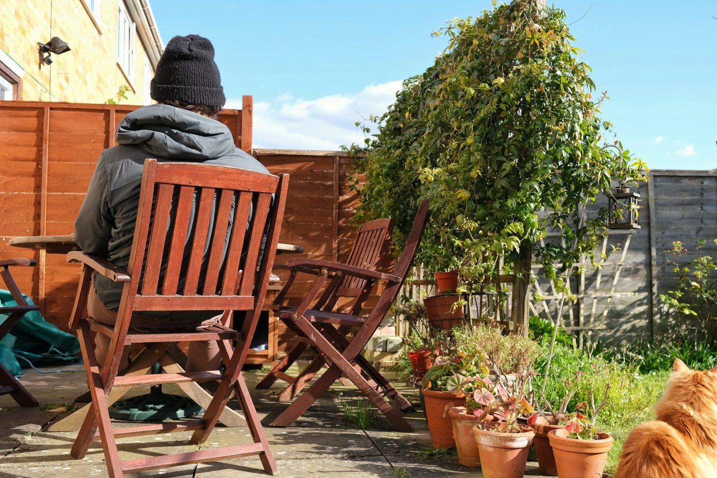 Man sitting in garden on sunny day