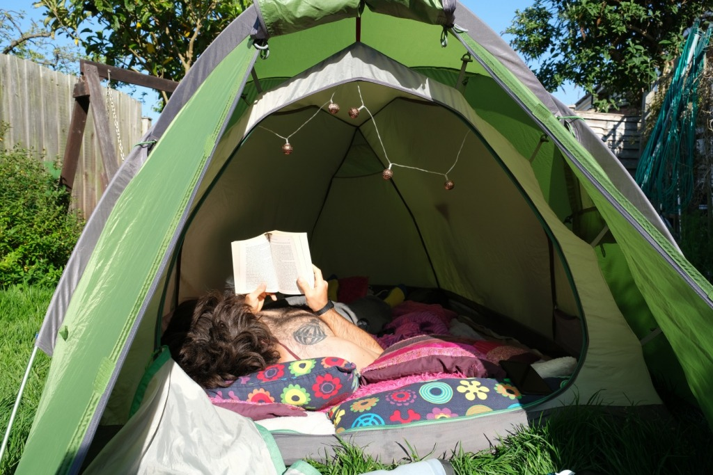 Man camping in his back garden