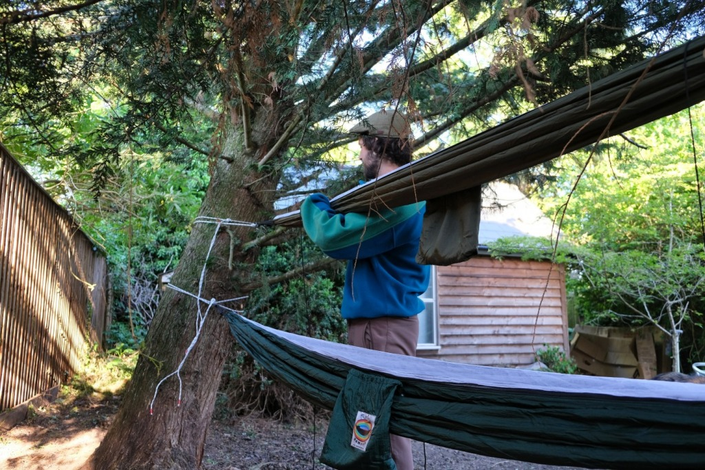 Pitching a camping hammock