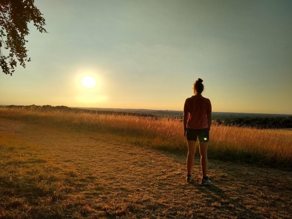 Girl trail running in sunshine