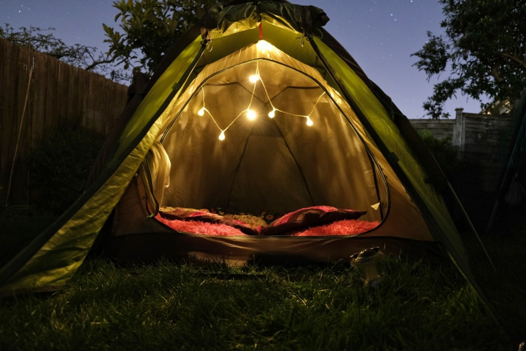 Camping tent lit with fairy lights