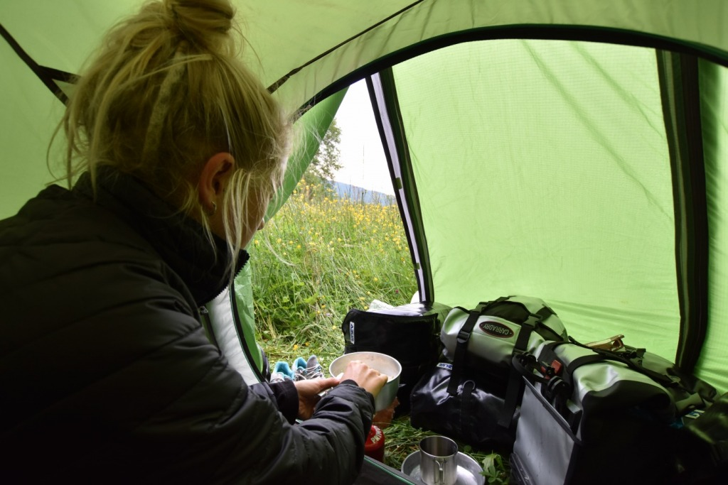 Girl camping in a tent