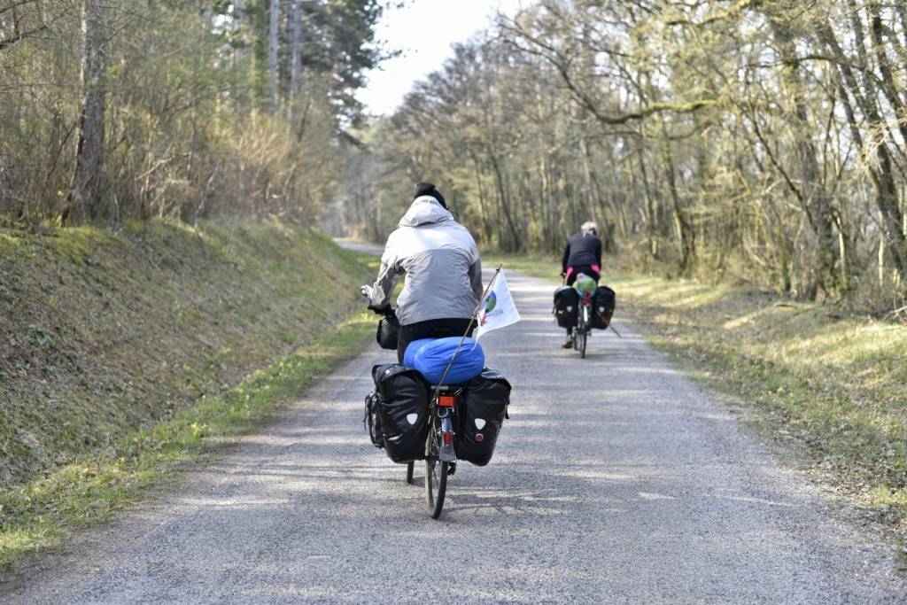Bike tourers with gear on road