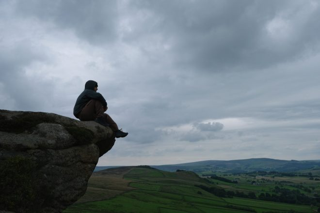 Man sitting on rocks in natural area