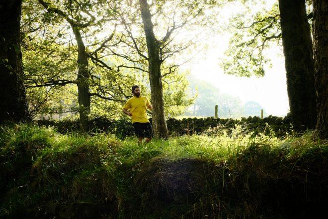 Man running through woods