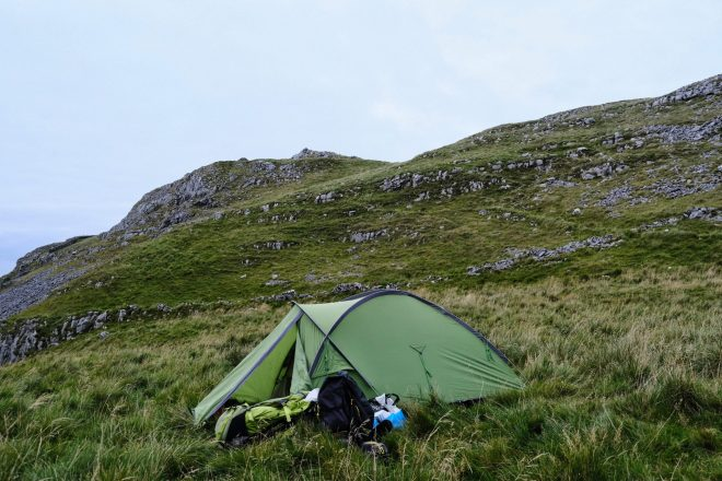 Wild camping tent on hillside